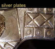 Extensive damage throughout silver plating.