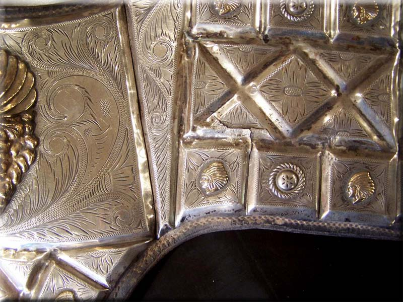 An example of the many cracks throughout all the silver plates. All cracks were then hard soldered and dents straightened
